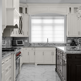 Huge traditional eat-in kitchen ideas - Inspiration for a huge timeless u-shaped eat-in kitchen remodel in Toronto with raised-panel cabinets, white cabinets, granite countertops, gray backsplash, granite backsplash, an island and gray countertops