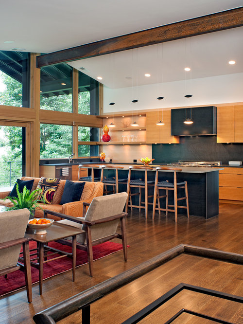 Inspiration for a contemporary l-shaped dark wood floor and brown floor  eat-in