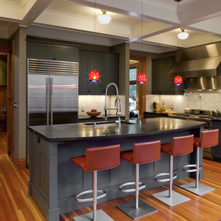 Traditional kitchen photos - Kitchen - traditional kitchen idea in Portland with shaker cabinets, gray cabinets, beige backsplash and stainless steel appliances