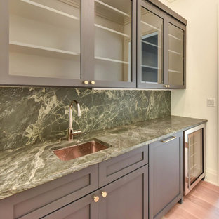 This is an example of a traditional kitchen in DC Metro with glass-front cabinets, blue cabinets, stone slab splashback, medium hardwood floors and green benchtop.