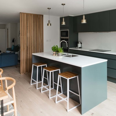 Eat-in kitchen - modern single-wall light wood floor eat-in kitchen idea in London with a drop-in sink, flat-panel cabinets, gray cabinets, quartzite countertops, an island and white countertops
