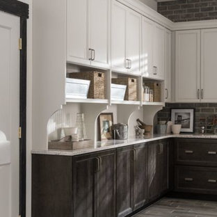 Design ideas for a mid-sized transitional l-shaped kitchen pantry in New Orleans with an undermount sink, shaker cabinets, grey cabinets, quartz benchtops, white splashback, cement tile splashback, stainless steel appliances, porcelain floors and with island.