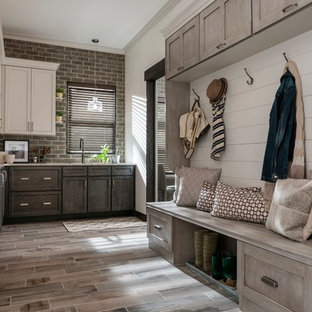 Inspiration for a medium sized rustic l-shaped kitchen pantry in Minneapolis with shaker cabinets, dark wood cabinets, granite worktops, brick splashback, porcelain flooring and beige floors.
