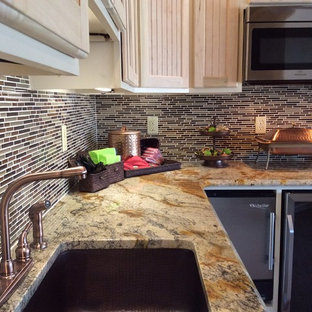 Photo of a large transitional u-shaped eat-in kitchen in Other with a single-bowl sink, louvered cabinets, light wood cabinets, granite benchtops, multi-coloured splashback, matchstick tile splashback, stainless steel appliances and carpet.