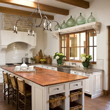 Mediterranean Kitchen by Desert Star Construction