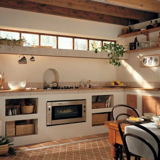 Inspiration for a mediterranean eat-in kitchen in Miami with open cabinets and no island.