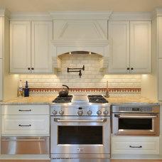 Mediterranean Kitchen by Innovative Construction Inc.