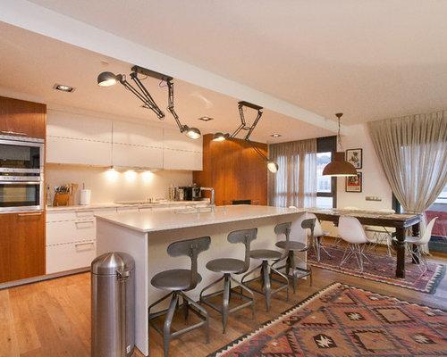 kitchen task lighting. inspiration for a large contemporary singlewall medium tone wood floor eatin kitchen task lighting