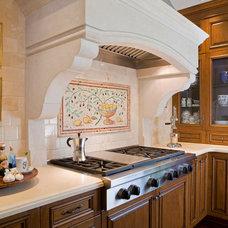 Mediterranean Kitchen by Hamilton-Gray Design, Inc.