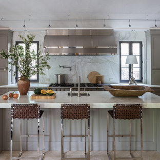 Mid-sized transitional eat-in kitchen remodeling - Mid-sized transitional u-shaped travertine floor eat-in kitchen photo in DC Metro with a farmhouse sink, recessed-panel cabinets, gray cabinets, marble countertops, gray backsplash, stainless steel appliances and an island