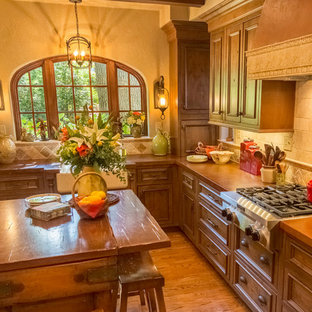 Small mediterranean eat-in kitchen appliance - Small tuscan l-shaped medium tone wood floor eat-in kitchen photo in St Louis with a farmhouse sink, shaker cabinets, medium tone wood cabinets, concrete countertops, beige backsplash, stone tile backsplash, stainless steel appliances and an island