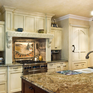 Inspiration for a large mediterranean u-shaped dark wood floor and brown floor enclosed kitchen remodel in Milwaukee with a farmhouse sink, shaker cabinets, white cabinets, granite countertops, beige backsplash, cement tile backsplash, stainless steel appliances and an island