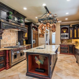 Mediterranean enclosed kitchen appliance - Enclosed kitchen - mediterranean beige floor enclosed kitchen idea in Sacramento with a double-bowl sink, raised-panel cabinets, distressed cabinets, beige backsplash, stainless steel appliances, an island and beige countertops