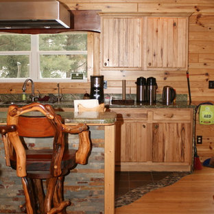 Inspiration for a large country l-shaped eat-in kitchen in Other with a double-bowl sink, louvered cabinets, light wood cabinets, granite benchtops, stainless steel appliances, slate floors, with island and multi-coloured floor.