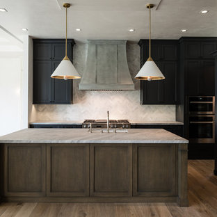 Design ideas for a large transitional l-shaped open plan kitchen in Miami with beige cabinets, marble benchtops, beige splashback, stainless steel appliances, medium hardwood floors, with island, an undermount sink, louvered cabinets and terra-cotta splashback.