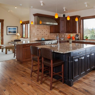 Inspiration for a timeless l-shaped open concept kitchen remodel in Other with an undermount sink, raised-panel cabinets, medium tone wood cabinets, beige backsplash and stainless steel appliances