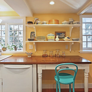 Victorian kitchen ideas - Example of an ornate kitchen design in Boston with a farmhouse sink, open cabinets, white cabinets, wood countertops and white appliances