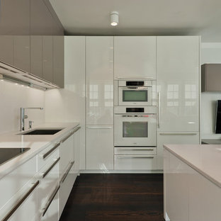 Design ideas for a small modern kitchen in Boston with an undermount sink, flat-panel cabinets, white cabinets, quartz benchtops, white appliances and with island.