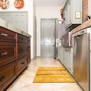 This is an example of a large traditional u-shaped kitchen pantry in Houston with a farmhouse sink, beaded inset cabinets, green cabinets, quartzite benchtops, brown splashback, metal splashback, stainless steel appliances, porcelain floors, with island, beige floor and green benchtop.