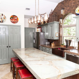 Design ideas for a large transitional u-shaped kitchen pantry in Houston with a farmhouse sink, beaded inset cabinets, green cabinets, quartzite benchtops, brown splashback, metal splashback, stainless steel appliances, porcelain floors, with island, beige floor and green benchtop.