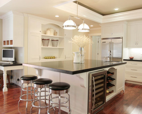 Example Of A Classic Kitchen Design In San Francisco With White Cabinets  And Stainless Steel Appliances