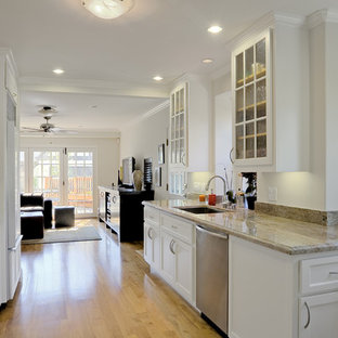 Mid-sized modern kitchen appliance - Kitchen - mid-sized modern galley light wood floor and yellow floor kitchen idea in San Francisco with marble countertops, glass-front cabinets, white cabinets, no island and an undermount sink