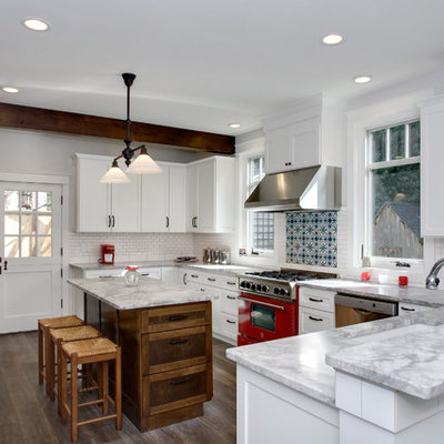 Kitchen - mid-sized traditional u-shaped kitchen idea in Seattle with colored appliances
