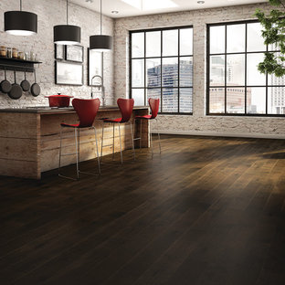 Inspiration for a large industrial dark wood floor kitchen pantry remodel in Other with an island