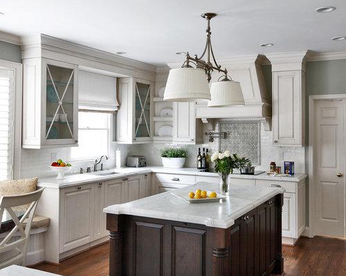 Glazed white kitchen cabinets & Carrera Marble Tops