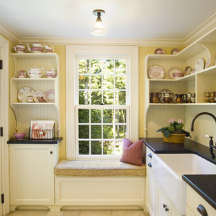 Mid-sized traditional enclosed kitchen designs - Inspiration for a mid-sized timeless single-wall limestone floor and beige floor enclosed kitchen remodel in Boston with a farmhouse sink, open cabinets, white cabinets, wood countertops, white backsplash and no island