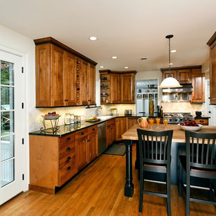 Ordinaire Elegant Kitchen Photo In DC Metro With Medium Tone Wood Cabinets And  Stainless Steel Appliances