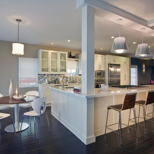 Large contemporary eat-in kitchen designs - Inspiration for a large contemporary dark wood floor eat-in kitchen remodel in Santa Barbara with stainless steel appliances, white cabinets, multicolored backsplash, matchstick tile backsplash and an island