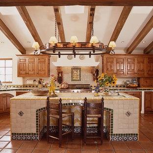 Southwestern kitchen remodeling - Example of a southwest kitchen design in Santa Barbara