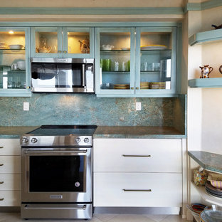 Design ideas for a mid-sized contemporary galley kitchen pantry in Miami with an undermount sink, glass-front cabinets, turquoise cabinets, granite benchtops, stainless steel appliances, marble floors, with island, beige floor and turquoise benchtop.