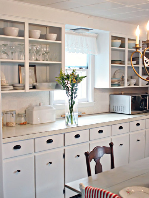 example of a coastal kitchen design in other - Small Cottage Kitchen