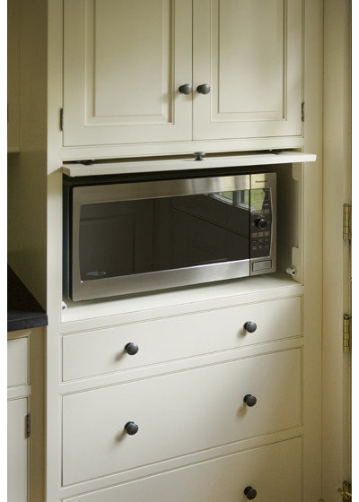 9 places to put the microwave in your kitchen for Built in place kitchen cabinets