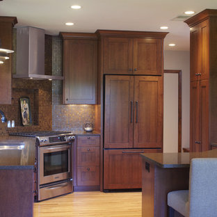 This is an example of a midcentury l-shaped eat-in kitchen in Minneapolis with an undermount sink, dark wood cabinets, quartz benchtops, brown splashback, mosaic tile splashback and panelled appliances.