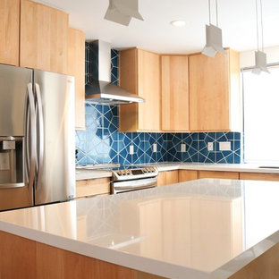 Inspiration for a large midcentury l-shaped open plan kitchen in Phoenix with an undermount sink, flat-panel cabinets, beige cabinets, quartz benchtops, blue splashback, ceramic splashback, stainless steel appliances, ceramic floors, with island, grey floor and white benchtop.