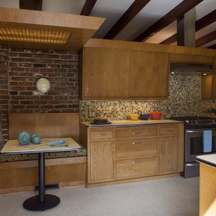 Photo of a mid-sized midcentury u-shaped separate kitchen in Portland with flat-panel cabinets, medium wood cabinets, laminate benchtops, multi-coloured splashback, mosaic tile splashback, stainless steel appliances and no island.