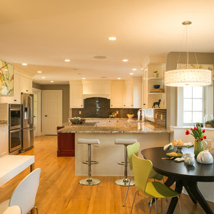 Mid-sized transitional u-shaped medium tone wood floor eat-in kitchen photo in Providence with recessed-panel cabinets, white cabinets, granite countertops, gray backsplash, glass tile backsplash, stainless steel appliances and an island