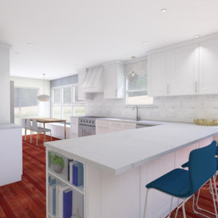 Design ideas for a mid-sized midcentury l-shaped eat-in kitchen with an undermount sink, shaker cabinets, white cabinets, quartz benchtops, white splashback, marble splashback, stainless steel appliances, dark hardwood floors, a peninsula, red floor and white benchtop.