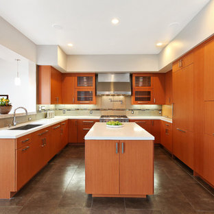 This is an example of a mid-sized midcentury u-shaped eat-in kitchen in Chicago with an undermount sink, flat-panel cabinets, light wood cabinets, quartz benchtops, beige splashback, porcelain splashback, stainless steel appliances, porcelain floors and with island.