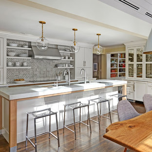 Design ideas for a large transitional u-shaped eat-in kitchen in Chicago with an undermount sink, shaker cabinets, white cabinets, marble benchtops, porcelain splashback, panelled appliances, with island, multi-coloured splashback, dark hardwood floors and brown floor.