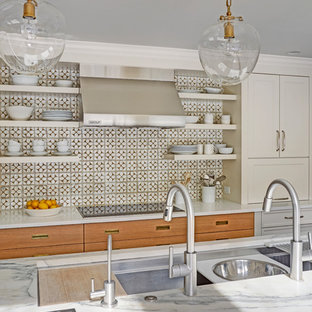 This is an example of a large midcentury u-shaped eat-in kitchen in Chicago with an undermount sink, shaker cabinets, white cabinets, marble benchtops, white splashback, porcelain splashback, panelled appliances, medium hardwood floors and with island.