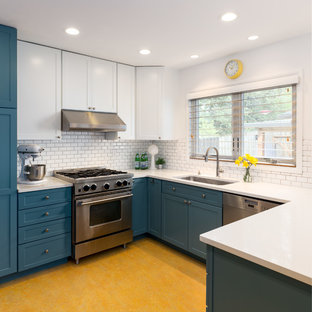 Inspiration for a mid-sized midcentury u-shaped eat-in kitchen in Portland with an undermount sink, shaker cabinets, blue cabinets, quartzite benchtops, white splashback, subway tile splashback, stainless steel appliances, linoleum floors, a peninsula and orange floor.