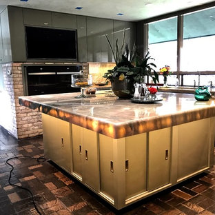 This is an example of a large midcentury u-shaped kitchen pantry in Austin with an undermount sink, flat-panel cabinets, beige cabinets, quartzite benchtops, green splashback, marble splashback, panelled appliances, brick floors, with island, multi-coloured floor and green benchtop.