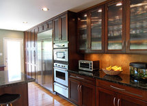 What color did you paint your kitchen walls?  Looks great with the dark cabinets!!!