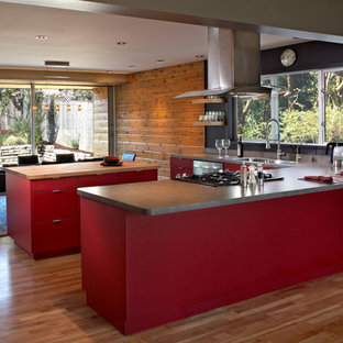 Design ideas for a midcentury kitchen in Portland with red cabinets.