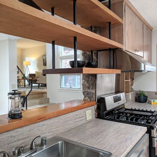 Design ideas for a mid-sized midcentury l-shaped eat-in kitchen in Other with a double-bowl sink, flat-panel cabinets, grey cabinets, laminate benchtops, stainless steel appliances, ceramic floors, no island, beige floor and grey benchtop.