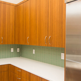 Midcentury l-shaped kitchen in Other with flat-panel cabinets, medium wood cabinets and with island.